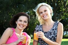 Lovely Women Drinking Wine Outdoors Stock Photo