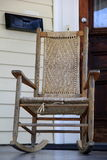 Lovely wood rocking chair on front porch. Of rural country home invites one to come and sit a spell Stock Images