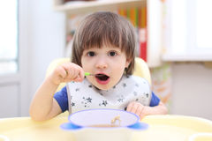Lovely 2 years boy has dinner Royalty Free Stock Images