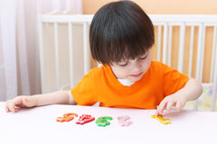 Lovely 2 years child learns to count. Educational game Stock Photo