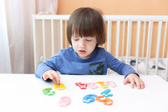 Lovely 2 years child learns to count at home. Educational game royalty free stock image