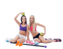 Lovely young athletes posing with sports equipment Royalty Free Stock Images