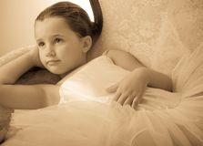 Lovely young ballerina lying on sofa Royalty Free Stock Photo