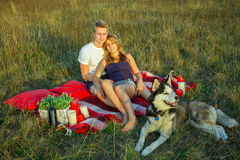 Lovely young beautiful couple resting in park Royalty Free Stock Photography