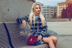 Lovely young blonde fashion model posing outdoors and looking aw Royalty Free Stock Image