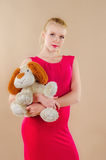 Lovely young blonde girl in a crimson dress Royalty Free Stock Photo