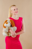Lovely young blonde girl in a crimson dress Stock Photo