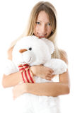 Lovely young blonde girl with teddy bear. Close-up lovely young blonde girl with teddy bear isolated on white background stock photo
