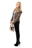 Lovely young blonde with a handbag Royalty Free Stock Photography
