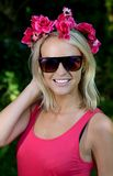Lovely Young Blonde Lady with Garland of Flowers. Pretty blond woman with a wreath of pretty spring flowers on her head Stock Images