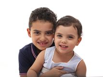Lovely Young Brother and Sister Smiling, Hugging and Looking at The Camera, Isolated stock image