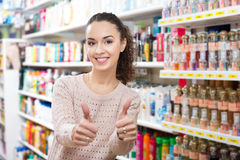 Lovely young brunette in beauty store. Portrait of lovely young brunette shopping in the beauty store Stock Images