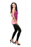 Lovely young brunette in a black leggings Stock Photography