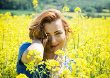 Lovely young brunette in rapeseed field Stock Image