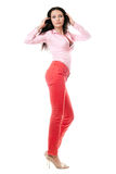 Lovely young brunette in red jeans Stock Image