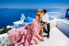The lovely young couple beautiful woman from handsome man. The lovely young couple beautiful women from handsome men relating to the beautiful Greek landscape Stock Image