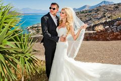 The lovely young couple beautiful woman from handsome man. The lovely young couple beautiful women from handsome men relating to the beautiful Greek landscape Stock Photo