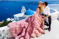 The lovely young couple beautiful woman from handsome man. The lovely young couple beautiful women from handsome men relating to the beautiful Greek landscape Royalty Free Stock Image
