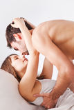 Lovely young couple in bed Stock Photos