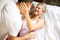 Lovely young couple in the bed Stock Image
