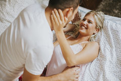 Lovely young couple in the bed Stock Photo