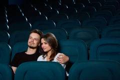 Lovely young couple on a date at the cinema stock image