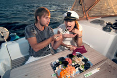Lovely young couple eating sushi Stock Photos