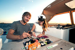 Lovely young couple eating sushi Stock Images