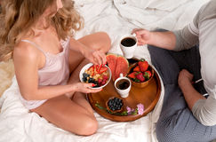 Lovely young couple having breakfast in bed Royalty Free Stock Photo