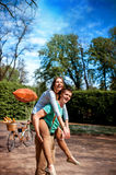 Lovely young couple having fun near the bicycle with red dirigib Royalty Free Stock Image