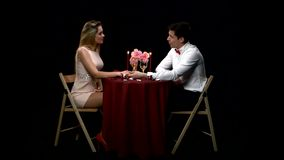 Lovely young couple having romantic dinner stock video