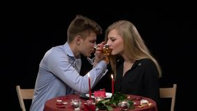 Lovely young couple having romantic dinner in stock footage