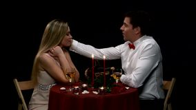 Lovely young couple having romantic evening. Close. Lovely young couple having romantic dinner in restaurant, candles, food, flowers, wine. Close up stock video footage