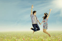 A lovely young couple jumping Stock Photo