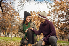 Lovely young couple laughing in autumn scenery Stock Photography