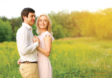 Lovely young couple in love outdoors in summer Stock Photos