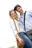 Lovely young couple outdoors smiling Royalty Free Stock Photography