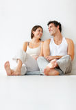 Lovely young couple relaxing on the floor Royalty Free Stock Photo