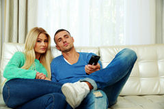 Lovely young couple sitting on the sofa Stock Photography