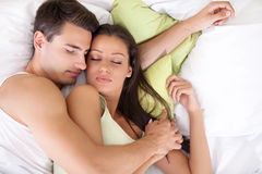 Lovely young  couple sleeping. Portrait of lovely young couple sleeping together on bed Royalty Free Stock Photos