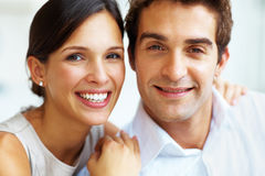 Lovely young couple smiling together Stock Photo