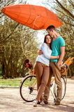 Lovely young couple standing and hugging near the bicycle with r Royalty Free Stock Photography