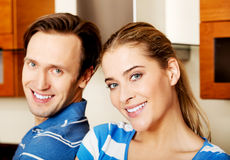 Lovely young couple standing in kitchen Stock Photos