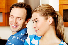 Lovely young couple standing in kitchen Royalty Free Stock Image