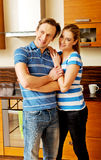 Lovely young couple standing in kitchen Royalty Free Stock Images