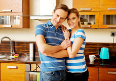 Lovely young couple standing in kitchen Stock Photography