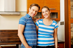 Lovely young couple standing in kitchen Stock Images