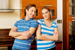Lovely young couple standing in kitchen Royalty Free Stock Photos
