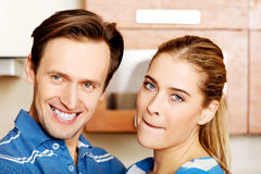 Lovely young couple standing in kitchen Stock Photo