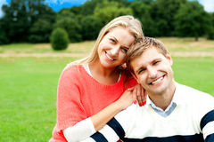 Lovely young couple striking a smiling pose Royalty Free Stock Images